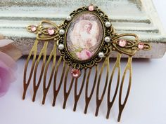 Noble Baroque hair comb in pink bronze, antique hair comb, hair comb Rococo, girls hair comb, ornate, rhinestone hair comb, pearl hair comb by Schmucktruhe on Etsy https://www.etsy.com/listing/172931560/noble-baroque-hair-comb-in-pink-bronze