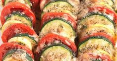 Parmesan Tomato Zucchini Bake is a simple recipe with layered fresh tomatoes, zucchini and summer squash topped with garlic, onions and parmesan cheese!