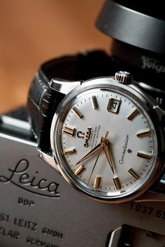 Vintage Omega Constellation & Leica camera. #watch #fashion #vintage #style #accessories