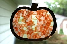 Use contact paper, construction paper and tissue paper to make a stained glass pumpkin