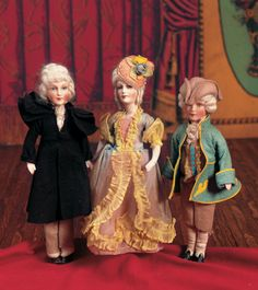 A Trio of German Composition Portrait Dolls View Catalog Item - Theriaults Antique Doll Auctions