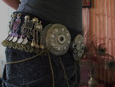 For those interested in a show stopping tribal fusion belt, here you are! The first two are my own performance belts, and not for sale. I like my belts simple, but yours can be as elaborate as you want- chains, coins, dangling fringe, rows upon rows of trim or metal, and so on.    This will be made with the real stuff! Genuine Kuchi pieces, Turkoman buttons, tribal gems and silver, and fabrics and trims imported from India. I try to buy everything directly from the artisans and exporters, so…
