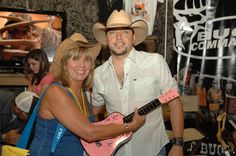 Jason Aldean meeting a fan in the Exhibit Hall at CMA Fest 2010.
