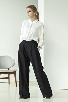 Black linen palazzo pants  These pants are cut from soft and breezy linen in a wide-leg silhouette. Wear yours with a tucked-in top or the to showcase the high-rise waist. Pockets concealed in side seams give extra comfort. These high-waist linen pants can be used in endless outfit combinations.