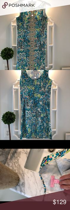 Lilly Pulitzer dress Lilly Pulitzer dress size 2.  This is by far my most favorite Lilly dress. Worn once but unfortunately not my size anymore!  I held onto it because I love it so much.  Now you can love it!  It's pretty but the colors a little more neutral.  The gold detail is a fun touch. Enjoy! Lilly Pulitzer Dresses