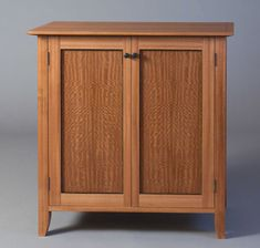 """Because this cabinet was made for a show in the Sonoma wine country, Thomas Starbuck Stockton designed it to hold wine. But he made the interior wine racks removable so the design would be flexible enough for another use. """"The cabinet also was a good way to use some odds and ends of nice veneer I had."""" Stockton makes furniture in Montgomery Creek, Calif. Sapele and ebony, 16D x 32W x 32H From FWW 273 Types Of Furniture, Fine Furniture, Wooden Furniture, Furniture Making, Furniture Design, Fine Woodworking, Woodworking Projects, Diy Projects, Furniture Inspiration"""