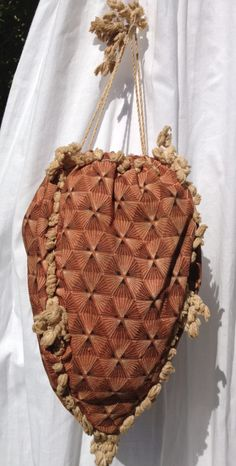 1820s cotton reticule. Pink, white and black geometric printed design. Pale pink tassels. Drawstring cord.