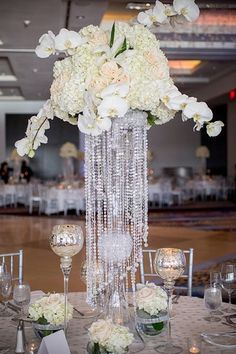 Wedding decoration has umpteen choices and tall centerpieces are one of the extravagant and spectacular décor that one can think of. Flowers are one of the most common things that never run out of … Decoration Table, Reception Decorations, Event Decor, Reception Ideas, Unique Centerpieces, Flower Centerpieces, Centerpiece Wedding, Crystal Centerpieces, Tall Centerpiece