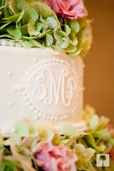 Wedding cake with monogram and hydrangeas.