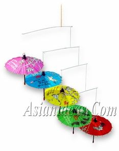 """Today's feature product: Floral Umbrella Mobile    Strung on thin wires, five miniature paper umbrellas mobile perform a balance act with their own weight. In Buddhist tradition, umbrellas represent spiritual authority and charity. Features:    • Richly colored in red, yellow, blue, pink & green  •Made from Paper and bamboo. Umbrellas are 6"""" dia x 5"""" height  • Mobile measures 27"""" height x 17"""" width    http://www.asianideas.com/raummo.html"""
