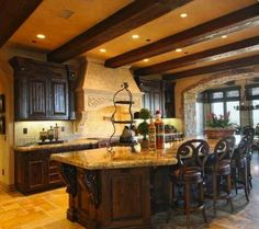 Tuscan Kitchen - Wood beams = important element in Tuscan style design.