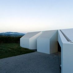 Casa+Rosto+do+Cão+by+M-Arquitectos++is+fronted+by+four+white+blocks