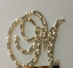 Swarovski Crystal & Pearl Monogram Cake Topper Any by OCsparkles $65  https://www.etsy.com/listing/217429921/swarovski-crystal-pearl-monogram-cake?ref=shop_home_active_1