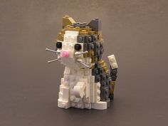 ok, this is just ridiculously cute. a little calico kitten with a pink nose, and little whiskers... all made out of white, grey, and bronze colored lego blocks.  it's just too adorable to even look at.