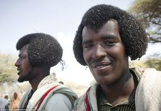 Men from the Karrayyu tribe cover their tradition afro hairstyles, known as gunfura, with butter