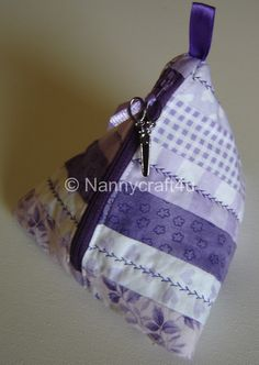 Good morning!!Today we are going to make a pyramid pouch – a handy little storage pouch that you can keep threads, ribbons,tools or just whatever you can think of in a handy place!What we need: 6 strips each 1.5″ x 11.5″Backing fabric rectanghle 11.5″ x 6″Rectangle of pellon 11″ x 5.5″a zip – longer than …
