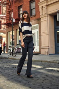 Flares: With a top tucked or half tucked  Like a fluid T-shirt, a cashmere sweater, a light shirt, etc.  The tucking in of half-tucking in is recommended for ladies with flat bellies.
