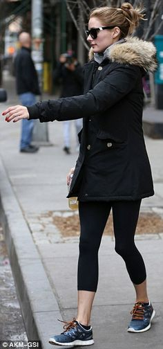 Rare dressed down day: The former reality TV star donned a parka with black leggings and b...