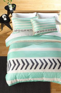 Obsessed with this mint stripes-and-arrows duvet cover and coordinating shams. The chic set will be perfect for the guest bedroom!