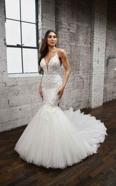 Elegant mermaid wedding dress. Plunging V-neckline wedding dress features illusion tulle with delicate beaded straps. The bodice and waist are covered in floral details, with dimensional texture and sparkling accents from sequins and beading throughout. Bead-encrusted details layer on top of illusion tulle. The skirt flares out just above the knee into a voluminous skirt with layers of soft tulle. The full train has a soft look for a romantic walk down the aisle. Martina Liana   Style: 1397 Fit And Flare Wedding Dress, Fit N Flare Dress, Wedding Dresses Plus Size, Designer Wedding Dresses, Bella Bridal, Bridal Gallery, Wedding Dress Necklines, Bridal Style, Bridal Gowns