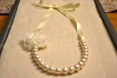 Rose: Ivory Pearl Necklace with Ivory Ribbon or Build Your Own. $11.00, via Etsy. Necklace for Evie?