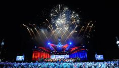 By shooting off fireworks over the stage, Queen's jubilee concert is brightened up by the sparks in the sky.