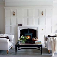 beef up the mantel with paneling.  Another floor to ceiling option for the fireplace.