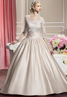 Re-embroidered lace appliques embellish a detachable sleeve jacket on this satin ball gown. Buttons add the finishing touch along the zipper to the end of the chapel train. Embellished Belt, Embroidered Lace, Lace Applique, Blush Bridal, Bridal Gowns, Wedding Gowns, Lace Jacket, Tulle Gown, Mermaid Gown