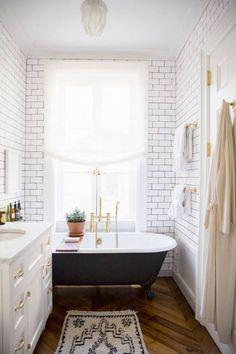 BATHROOM / CHEVRON FLOOR / WHITE TILE / CLAW FOOT TUB