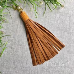 Large cognac leather tassel with ostrich skin top