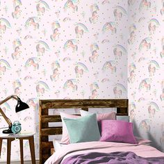 Rainbow Unicorn Glitter Wallpaper Pink Arthouse 696108  The Rainbow Unicorn Wallpaper by Arthouse will add a touch of magic to your little one's bedroom or playroom. The charming design is full of glistening unicorns, glittering clouds and sparkling rainbows all set upon a pink background. This wallpaper could be used to create a stylish feature wall or to decorate an entire room. Coordinating wallpapers are also available from the Arthouse Glitterarti range in a variety of colours includ...