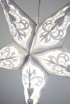 beautiful white star lantern that you can use to decorate your winter wedding recepetion
