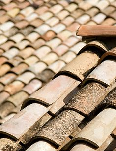 Genuine antique terra cotta roof tiles. Variation of hue, shape and color makes antique terra cotta a unique and impressive material. Lovingly salvaged. Exquisite Surfaces