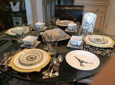 Primarily black & white theme table from The Frenchy in Me board. French theme includes Eiffel Tower on dishes, but other royal symbols like the crown and bees on flatware & glasses. See my board for more details, options & buffet with Eiffel Tower wine rack & bee hive beverage dispenser.