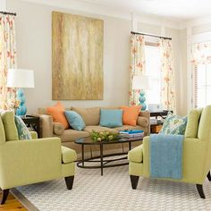 Engaging Color Scheme ~ Apple Green + Blue + Orange   An open floor plan and breezy colors give this family room an engaging look. Furniture with traditional and simple lines puts the focus on the happy hues. The islands of neutrals and muted greens get punched up with fun splashes of blue and citrus along with energetic geometric and floral patterns.
