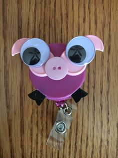 ID badge holder clip made from recycled medication vial caps Badge Holder Clips, Badge Reel, Homemade Gifts For Girlfriend, Pig Ideas, Name Badges, Button Art, Nursing, Round Sunglasses, Medicine