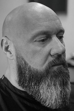 Bald Head And Full Beard The bald head hairstyle manual with essential tips on shaving, maintaining and looking after. Get yourself one of the boldest hair looks ever. Bald Head Man, Shaved Head With Beard, Bald Heads, Shaved Heads, Bald Men With Beards, Bald With Beard, Grey Beards, Full Beard, Long Beard Styles