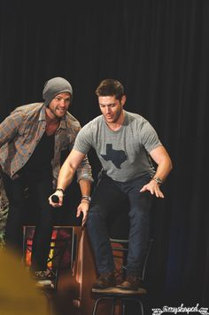 "grumpyjackles: "" these two getting ready for the big jump. shortly after this Jensen realized how bad an idea this was since the chairs swivel. Jared Padalecki & Jensen Ackles - Main Panel - Salute to Supernatural Dallas 2016 photo by me. if using -..."