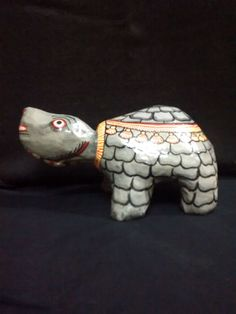 A papier mache toy of a tortoise painted in by PattachitraNet