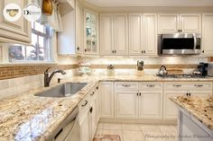 Another stunning view of the Wellington kitchen in Ivory glaze completed by DK Kitchen Design Center!
