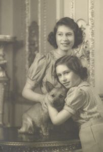 Princesses Elizabeth and Margaret with Dookie, their corgie. Taken at Windsor in 1941.