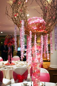 A birch twig structure with garlands of Hyacinths heads. For a girly birthday.