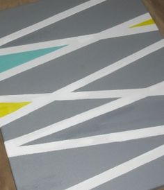 Tape and paint canvas - @Cassandra Packham and @Rhiannon MacPhail, we need to do a girls night together and make this!