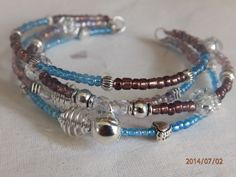 Blue and Purple seed beads with sparkling Crystals Silver spiral alloy spacers and a Silver Bell    £6.00