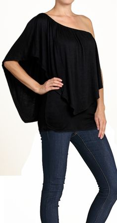 ZELDA TOP An amazing top that can be worn THREE ways! On both shoulders, Off both shoulders or Off one shoulder. The neckline has an elastic which means it won't slip down as you wear it. The layer on top is flattering and has the added bonus of covering the mid section.