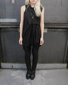 Draped/gathered dress, very simple necklace, not so keen on the leggings but could have plain/leather?