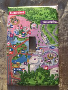 Walt DIsney World Magic Kingdom map light switch cover. Would be fun to do w/ all the maps we collected...