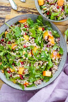 Barley salad with kaki, pomegranate, pine nuts, fresh herbs and arugula recipe