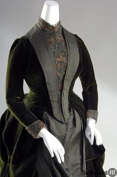 Dress, c 1888.  Madame Arnaud's Rue Bassano address did not put her at the geographic center of Paris fashion, but this elaborate morning dress nonetheless identifies her as a talented couturière. Her interest in sumptuous materials is evident in the richly colored fabrics that drape and fold to create the skirt's sculptural form. The top folds of the velvet overskirt are stiffened to maintain an origami-like shape.
