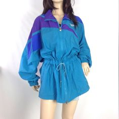 Vintage 80s Reebok nylon windbreaker track jacket. Zipper front with drawstring waist. Mesh vented back. Unlined. Hip pockets. PLEASE NOTE the